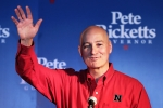 Governor Ricketts, waves to crazy lady Sarah Palin after she endorsed him.