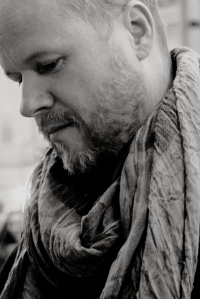 Joss Whedon by Caroline van Oosten de Boer via Flickr.  He looks very pensive, does he not?